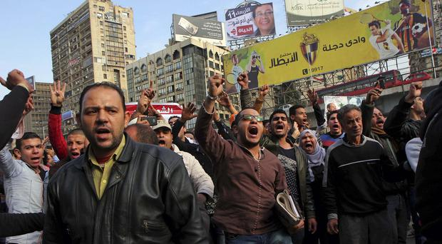 Protesters chant slogans in Cairo as Egyptian police moved to break up scattered protests marking the anniversary of the 2011 uprising that toppled Hosni Mubarak (AP Photo/Hassan Mohamed)
