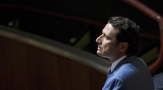 Captain Francesco Schettino waits for the arrival of the judges in the courtroom. (AP)