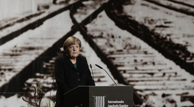 German Chancellor Angela Merkel delivers her speech during an event commemorating the 70th anniversary of the liberation of the Auschwitz Nazi death camp. (AP)