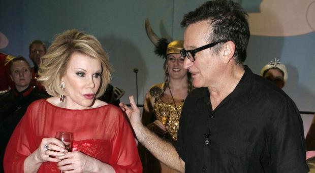 Joan Rivers, pictured with Robin Williams, died after a procedure at a New York clinic