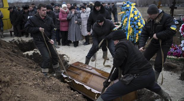 Alexander Demyanenko, a victim of the Mariupol shelling, is buried (AP)