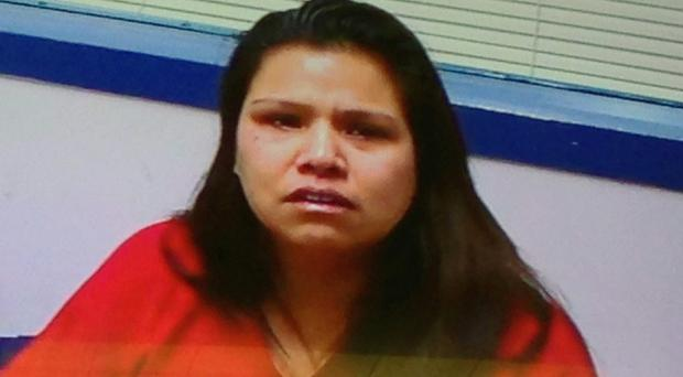 Christina Booth told police she cut her three children's throats to keep them quiet for her husband (The Olympian/AP)