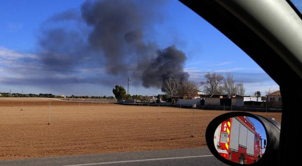 Smoke rises from a military base after a plane crash in Albacete, Spain (AP Photo/Josema Moreno)