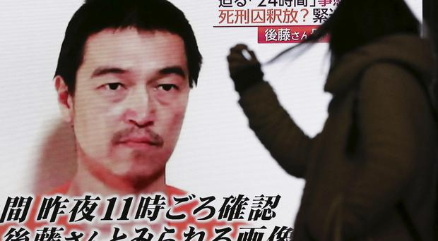 A video posted on YouTube by jihadists purports to show a photo of Japanese hostage Kenji Goto (AP)