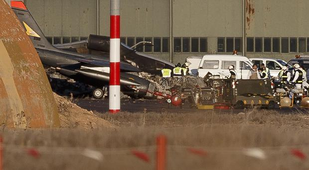 Investigators work around the wreckage of planes the day after the crash at Albacete air base. (AP)