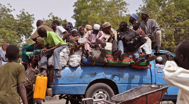 Villagers flee the violence near the city of Maiduguri, Nigeria. (AP)