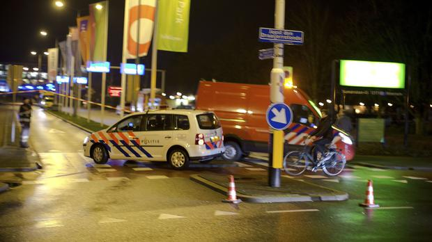 A police vehicle enters the Media Park in Hilversum, where the teenager was taken into custody (AP)