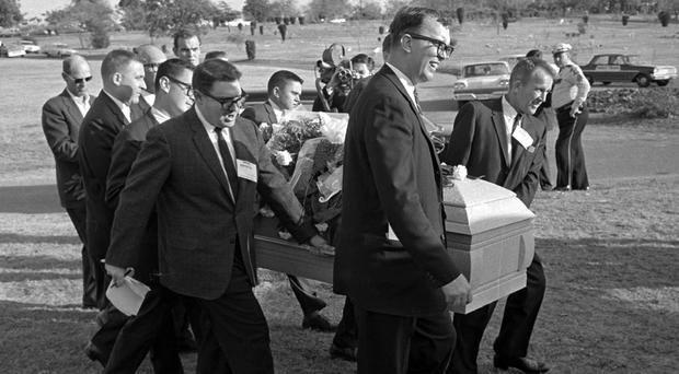 Reporters were enlisted to act as pall bearers at the burial of Lee Harvey Oswald at the Shannon Rose Hill Cemetery in Fort Worth, Texas (AP)