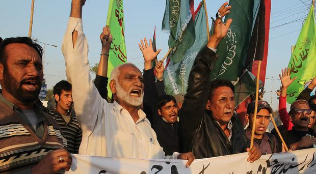 Pakistani protesters condemn a bombing at a Shiite mosque (AP)
