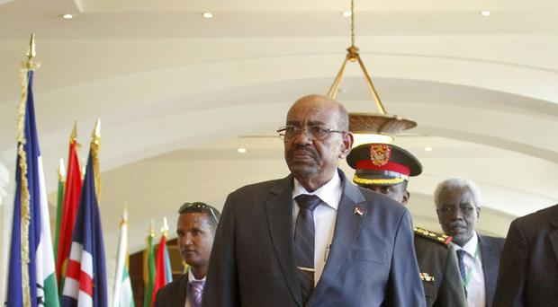 Sudan's president Omar al-Bashir arrives for a two-day meeting of African leaders in the Ethiopian capital Addis Ababa (AP)