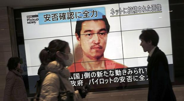 Japan's cabinet is meeting to discuss the apparent murder of Kenji Goto by IS