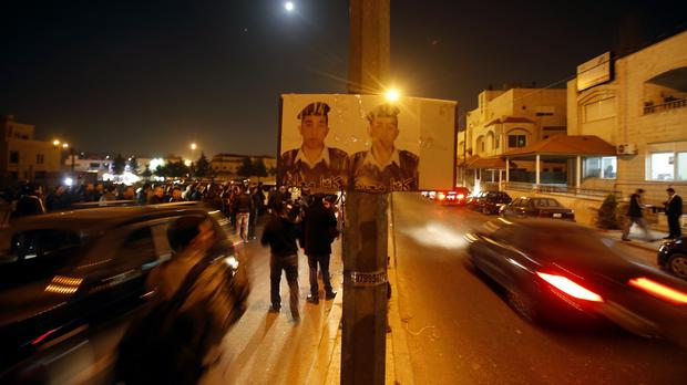 Supporters and family members of Jordanian pilot, Lt Moaz al Kasasbeh gather in Amman after his reported killing (AP)
