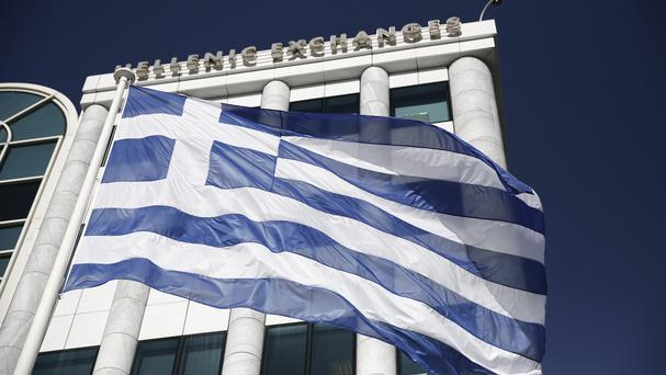 A Greek flag flies outside the Athens Stock Exchange