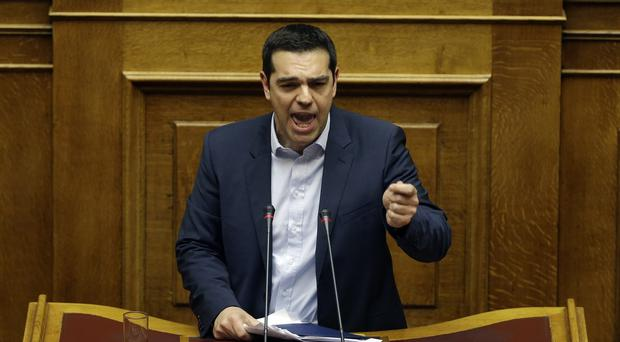 Greek prime minister Alexis Tsipras addresses the parliament during his government's policy statement in Athens (AP)