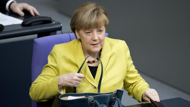 Chancellor Angela Merkel arrives for the debate at the German parliament