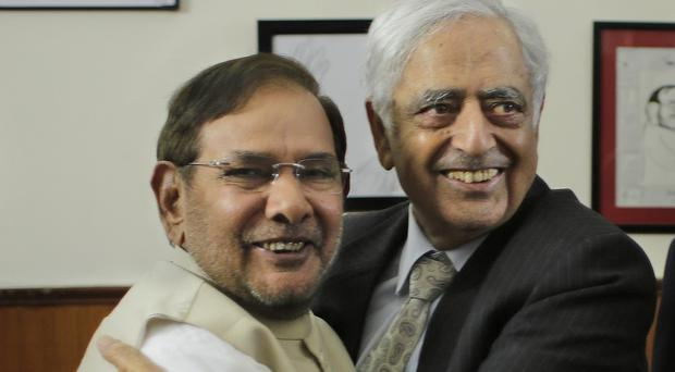 Peoples Democratic Party leader Mufti Mohammed Sayeed, right, will be Kashmir's chief minister. (AP)