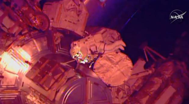 In this image from Nasa television astronaut Terry Virts exits the Quest airlock hatch to begin the third spacewalk outside the International Space Station (AP/Nasa-TV)