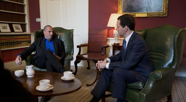Greece's new anti-austerity finance minister Yanis Varoufakis (left) during a meeting with George Osborne