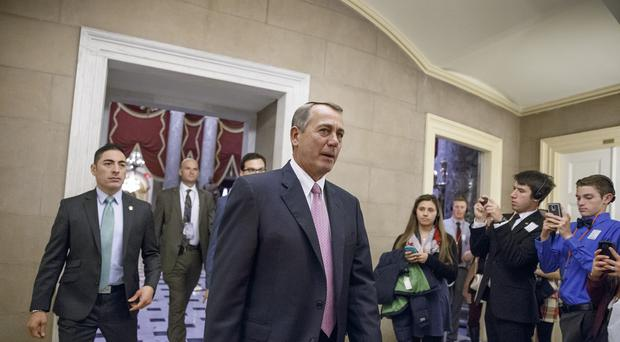 House Speaker John Boehner returns to his office on Capitol Hill in Washington (AP)
