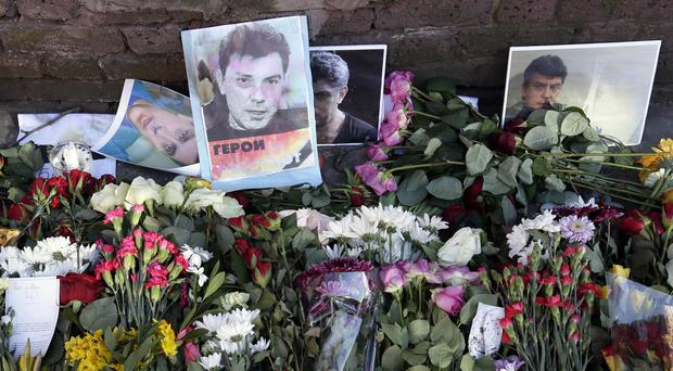 Flowers are placed outside the Russian embassy in London for murdered Kremlin critic Boris Nemtsov (AP)