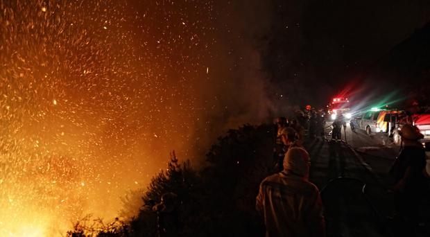 Firemen battle a blaze near Cape Town. (AP)