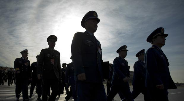 Chinese military officers arrive at the Great Hall of the People in Beijing (AP)