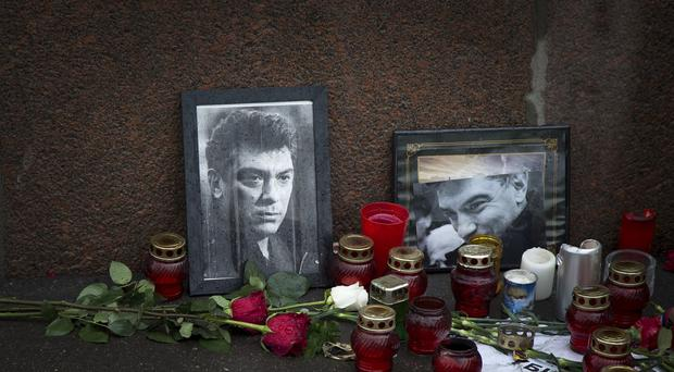 Tributes at the scene in Moscow where Russian opposition politician Boris Nemtsov was shot dead (AP Photo/Alexander Zemlianichenko)