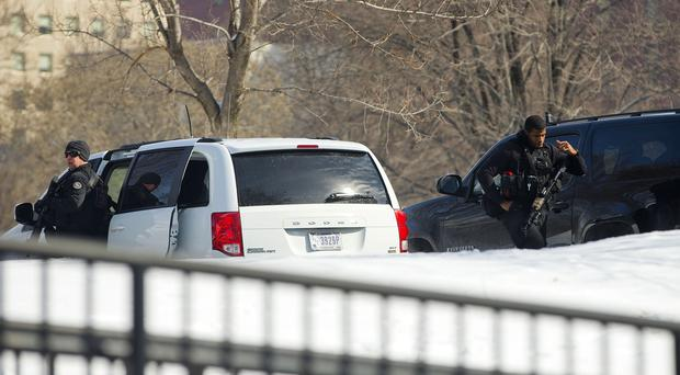 Members of the US Secret Service's counter assault team near their vehicles on the North Lawn of the White House (AP)