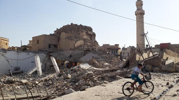 Isis militants have destroyed ancient sites including the centuries-old Mosque of the Prophet Younis in Mosul (AP)