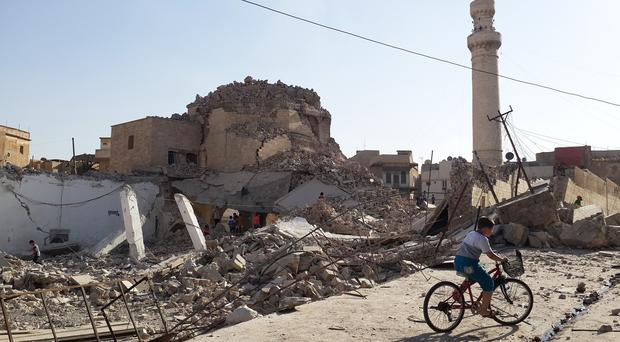 IS militants have destroyed ancient sites including the centuries-old Mosque of the Prophet Younis in Mosul (AP)