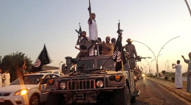 Islamic State, which controls about a third of Syria and Iraq, sells black-market oil to fund its conquests (AP)
