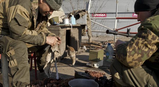 Russia-backed rebels perform weapons maintenance on the outskirts of Debaltseve, Ukraine (AP)