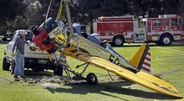 The Second World War-era plane is removed from Penmar Golf Course in the Venice area of Los Angeles (AP)