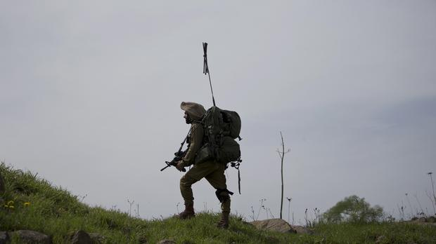 An Israeli soldier trains in the Israeli-controlled Golan Heights, near the border with Syria (AP/Ariel Schalit)