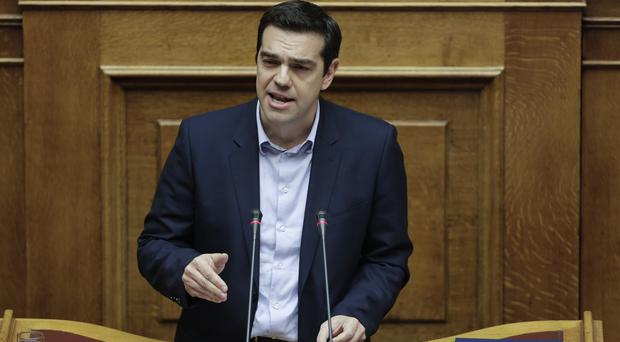 Greece's Prime Minister Alexis Tsipras spoke during a debate on whether to revive a parliamentary committee that would seek German reparations. (AP)