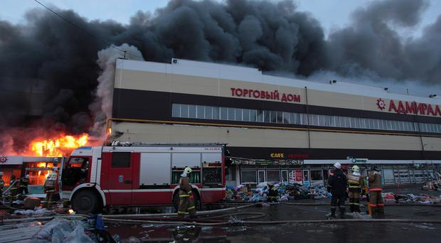The shopping centre in Kazan collapsed amid the fire (AP)