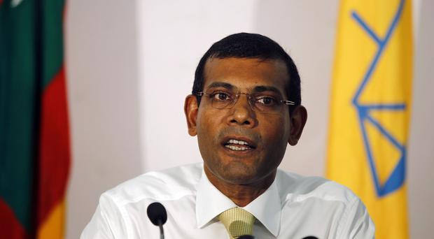 Former Maldives president Mohamed Nasheed has been convicted and sentenced to 13 years in prison (AP)