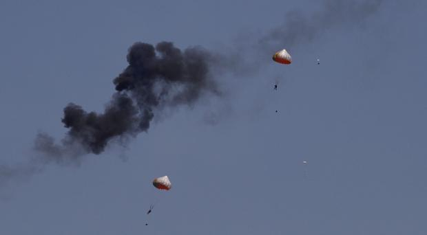 Pilots from Indonesia's aerobatics team ejected after a mid-air collision (AP)