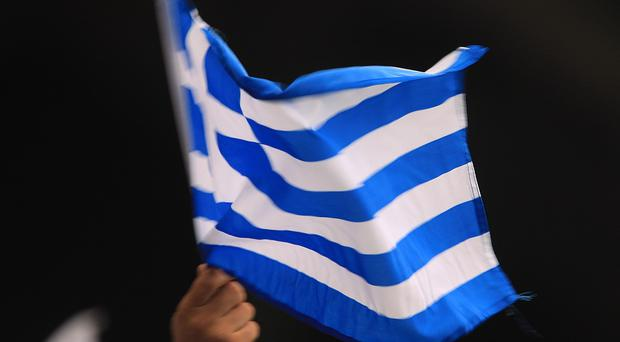 The Greek economy has slipped into deficit, according to bank figures