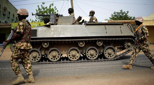 Nigerian troops patrol in the north-eastern city of Mubi, some 14 miles west of the Cameroon border (AP)