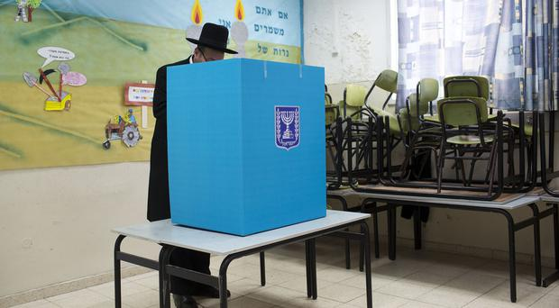 An Ultra orthodox Jew votes in Bnei Brak, Israel (AP)
