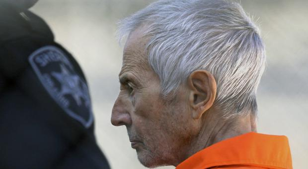 Robert Durst is escorted into Orleans Parish Prison after his arraignment in Orleans Parish Criminal District Court in New Orleans (AP)