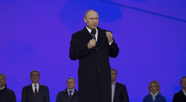 Vladimir Putin has urged Russia's business leaders to return their capital to the country (AP Photo/Pavel Golovkin)
