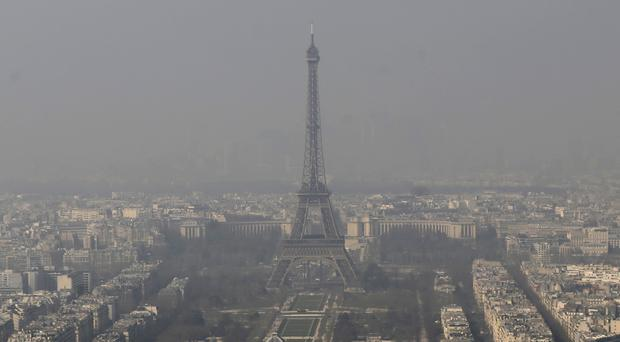 The Eiffel Tower pictured amid the smog in Paris. (AP)