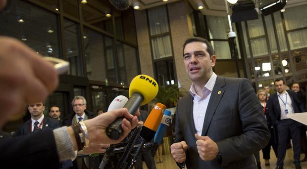 Greek prime minister Alexis Tsipras speaks with the media during the EU summit in Brussels (AP)