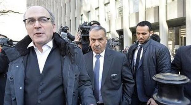 Mohammed Jaser, centre, father of Raed Jaser, leaves court after his son and Chiheb Esseghaier were found guilty (AP/The Canadian Press)