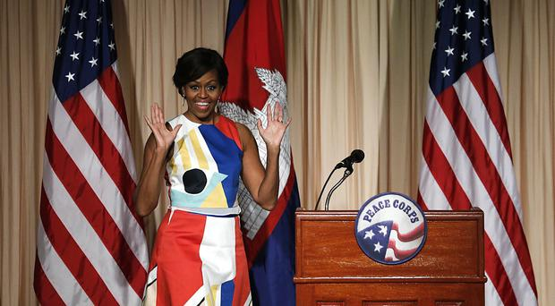 Michelle Obama waves as she arrives to speak to the Peace Corps Siem Reap, Cambodia (AP)