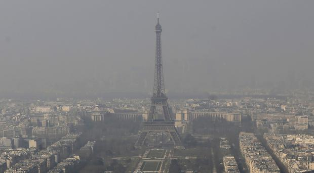 The Eiffel Tower, as seen through the smog in Paris as authorities announced emergency measures to tackle pollution. (AP)