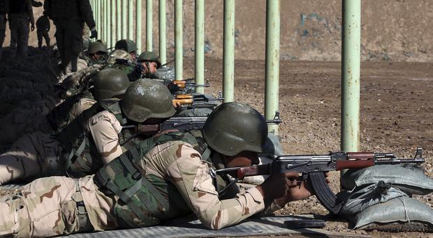 Iraqi security forces participate in a drill as US forces train them in Taji, north of Baghdad (AP)