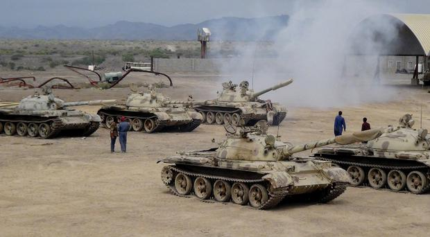 Militiamen loyal to Yemen's President Abed Rabbo Mansour Hadi take positions at the al-Anad air base, which was later captured by Houthi rebels (AP)